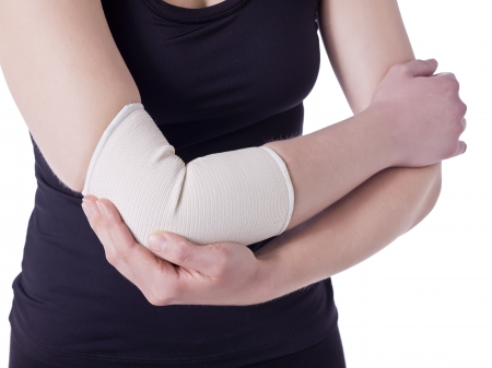 Image of an athlete woman having an elbow pain wrapped with a bandage against the white background Stock Photo - 16995612