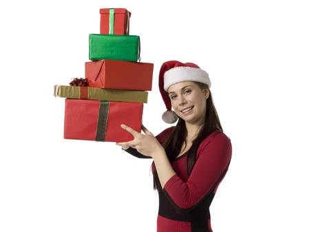 Image of attractive christmas woman smiling while holding gifts against white background Stock Photo - 16993073