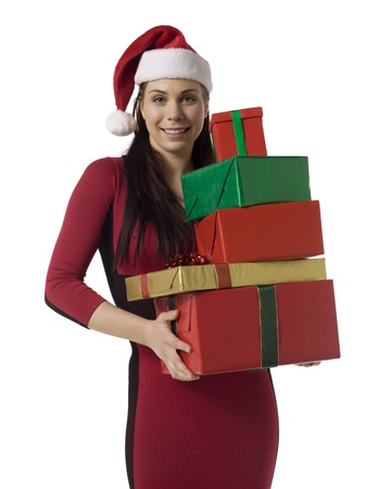 Image of attractive lady wearing santa hat holding gifts against white background Stock Photo - 16993161