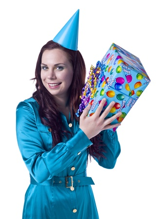 Close-up image of a happy woman wearing a party hat and holding a birthday gift smiling on a white background Stock Photo - 16993187