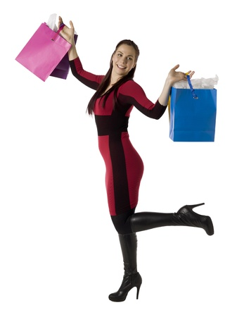Image of a happy woman holding shopping bags isolated on a white background Stock Photo - 16993129