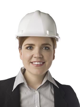female architect: Close-up image of a beautiful female architect smiling over the white background Stock Photo