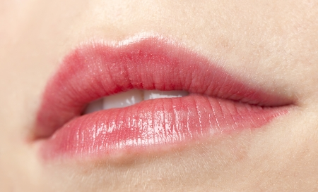 Close-up shot to the pink lips of a lady Stock Photo - 16993218