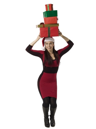 Image of crhistmas woman with gifts on her head against white background Stock Photo - 16993361