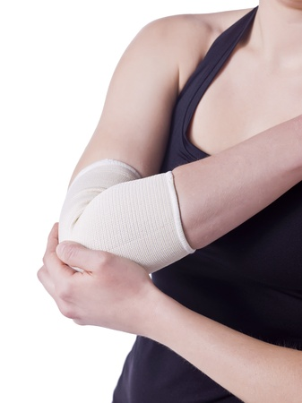 elbow brace: Image of elbow band in female elbow against white background