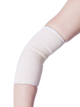 Injured elbow wrapped with a medical bandage Stock Photo - 16995392