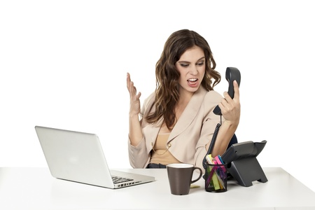 Image of upset female office clerk yelling to the phone Stock Photo - 16993064