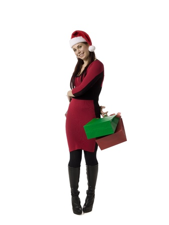 Image of happy shopping Christmas woman carrying papers bags against white background Stock Photo - 16993125