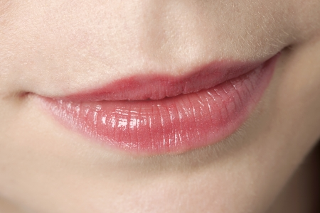 Close up image of a face of a woman with the camera focused on her sensual lips Stock Photo - 16993207