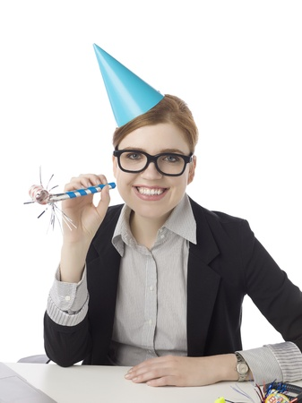 Image of smiling female office clerk with party favors against white background photo