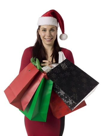Image of smiling shopping  christmas  girl girl holding paper bags Stock Photo - 16993144