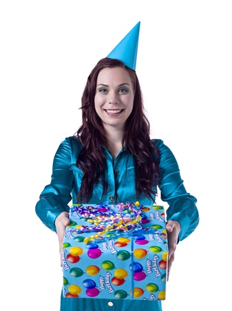 Caucasian woman wearing party hat giving a birthday gift Stock Photo - 16993137