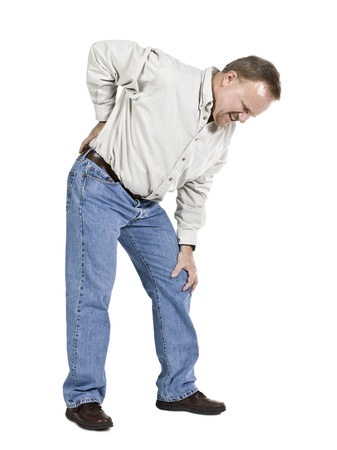 arthritis pain: Old man suffering back pain isolated in a white background