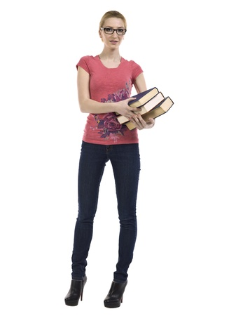 educational tools: Portrait of a beautiful female student holding books standing on a white background