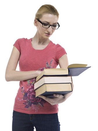 educational tools: Close-up image of a female student reading book against the white surface