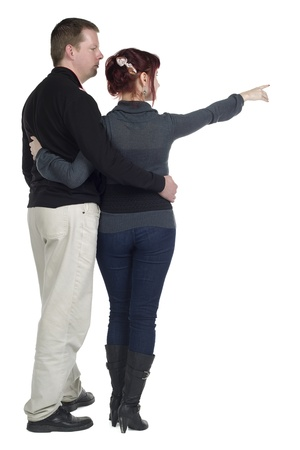 Back view of a mature couple pointing to the side of a white background Stock Photo