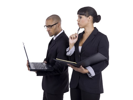 Close-up image of the two businesspeople discussing with a laptop against the white background Stock Photo - 17083785