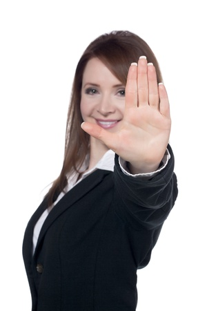 Close-up image of a happy businesswoman with a stop gesture against the white surface photo