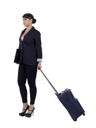 business traveler: Portrait of a female business traveler pulling a luggage