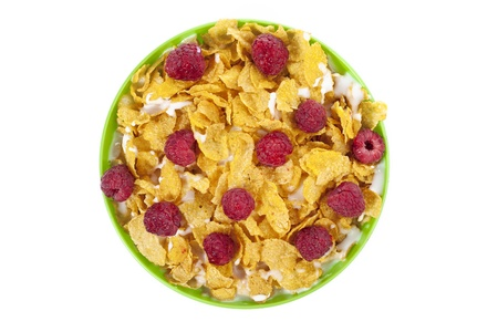 A top view image of corn flakes bowl with raspberries Stock Photo - 16999004