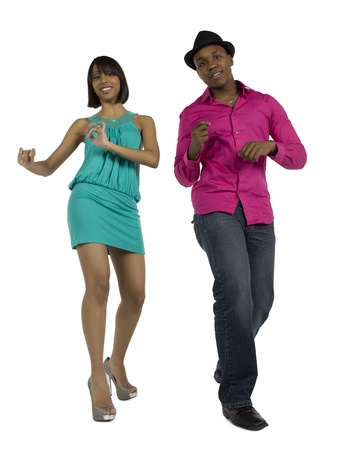 Young man and woman gracefully dancing over a white background photo