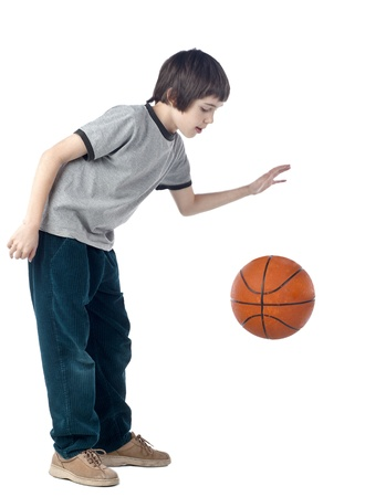 bounce: Portrait of a boy dribbling a basketball Stock Photo