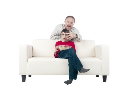 Image of a father and son on the sofa while watching horror movie Stock Photo - 17050813