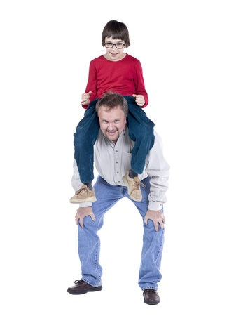 Father carrying his son on his shoulder as he bend slightly Stock Photo - 17050814