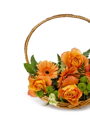 A cropped close up flower bouquet on a decorative basket isolated on photo