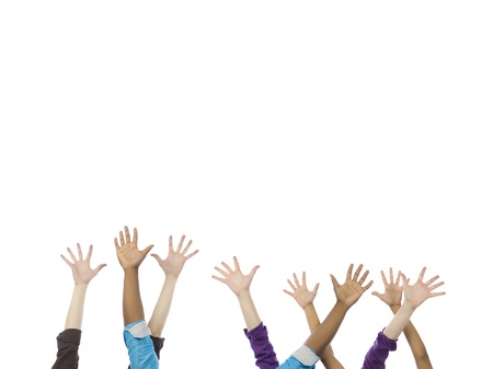 Close-up image of a group of hands gesturing at high five over the white surface Stock Photo - 16996070