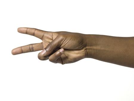 simbolo de la paz: Imagen de primer plano de una mano humana con el signo de la paz Foto de archivo