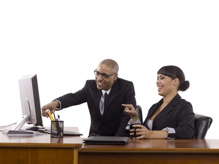 Image of happy business people pointing on the computer against white background Stock Photo - 17083732