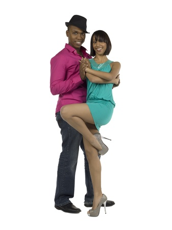 Full length portrait of happy couple dancing against white background photo