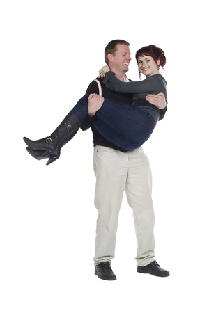 Guy carrying woman with her arms around his neck Stock Photo - 17083286