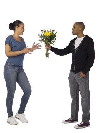 Man giving woman a bouquet of flowers photo