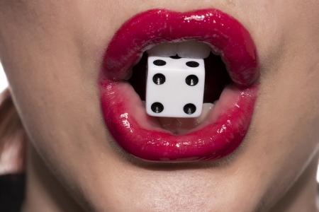 Closeup womans mouth with gambling dice