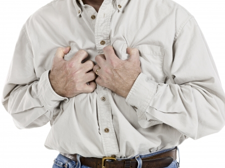 Portrait of senior man clutching his chest because of heart attack photo
