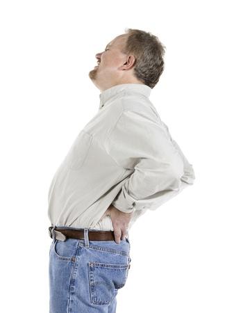 elderly pain: Uomo anziano che tiene la sua schiena dolorante su uno sfondo bianco