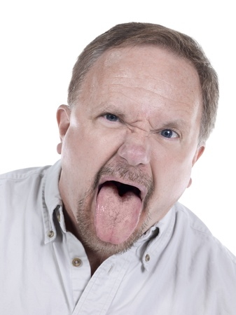 aging face: Portrait of a senior man with his tongue out on a white background