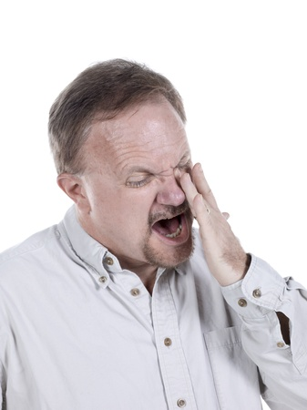 Close-up image of a senior man with sinusitis crying over the white background
