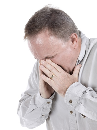 sinusitis: Close-up image of a senior man having a sinusitis isolated on a white surface