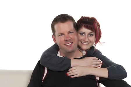 tenderly: Portrait of smiling girl on mans back hugging him tenderly