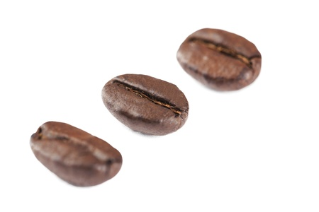 diagonal: Coffee grains forming a diagonal line on a white background