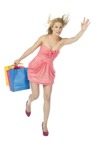Portrait of a waving female shopper rushing for a cab Stock Photo - 17083424