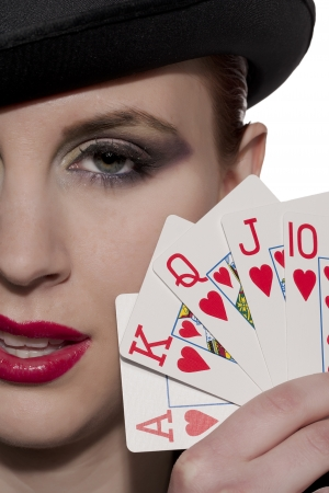 Close up image of woman holding playing cards photo