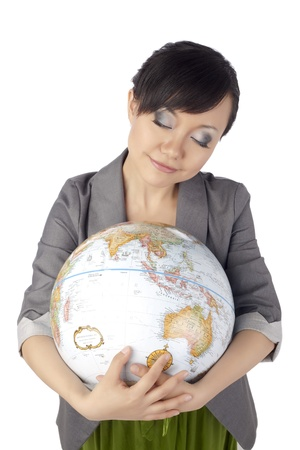 Portrait of an asian woman hugging a globe Stock Photo - 17084680