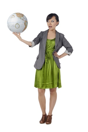 Full length portrait of attractive woman holding globe against white background Stock Photo - 17084169
