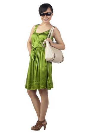Portrait of a beautiful lady traveler standing on a white background Stock Photo - 17071070