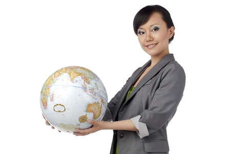 Close-up image of a happy female holding the globe isolated on a white surface Stock Photo - 17084431