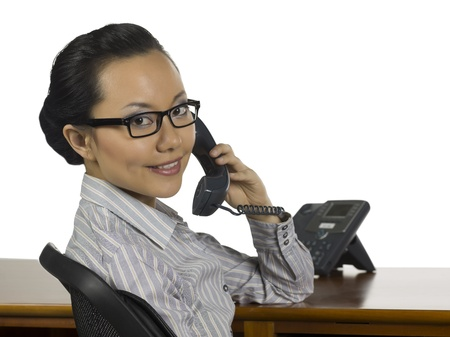 phone operator: Close-up image of a happy female phone operator against the white background Stock Photo
